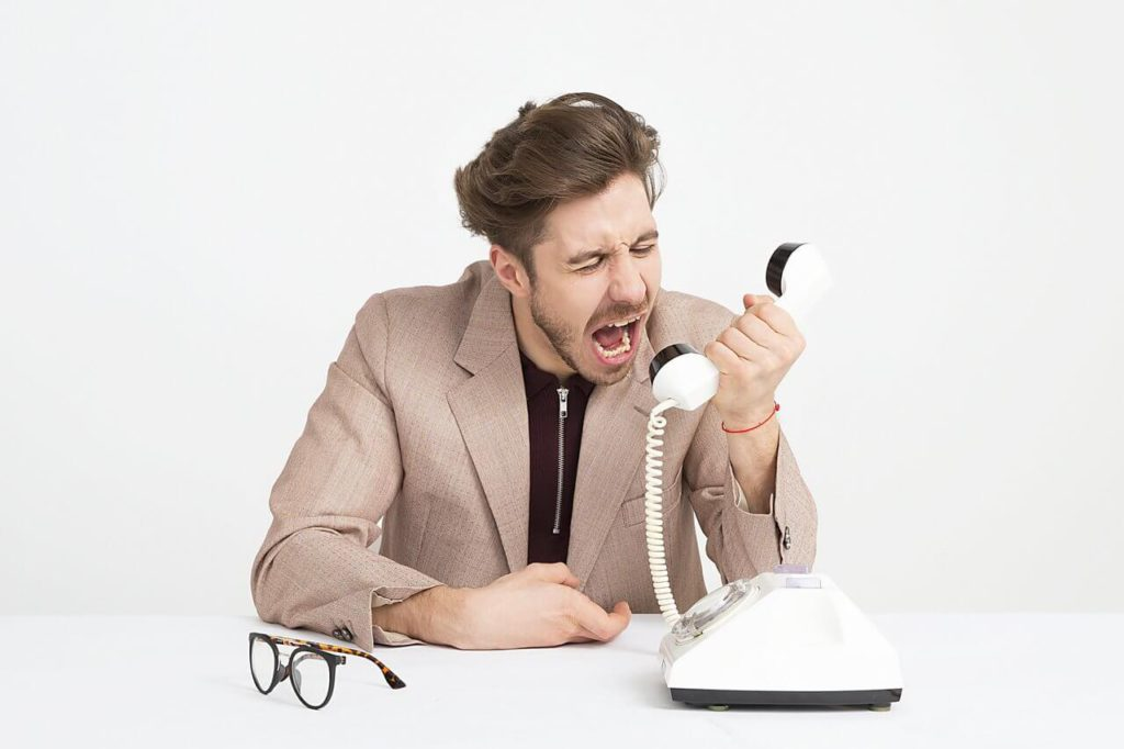 man shouting on phone
